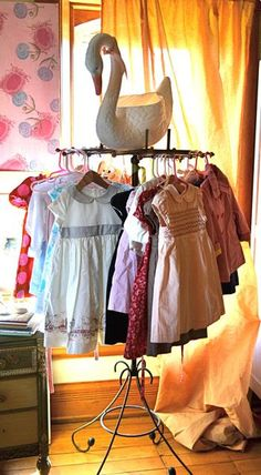Such a cute way to display little girl's dresses (pinned from A Sort Of Fairytale)