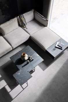 From the iconic Daybed to the grand Modular Sofa, all HANDVÄRK seating objects are meticulously designed in Denmark and characterized by aesthetic sustainability: a timeless object in a quality last a lifetime. Design Scandinavian, Nordic Interior Design, Home Interior, Dark Table, Black Side Table, Black Marble Coffee Table, Tile Top Tables, Nordic Living Room, Home Modern