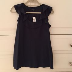 *NWT* Banana Republic Navy Ruffle Top Navy silk ruffle top! Very Cute ! Perfect in the summer with white jeans! Wear to work or just for a night out with friends!! Wish I could wear it just does not fit me right ! Banana Republic Tops Tank Tops
