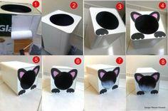 casa para gatos com lata de tinta