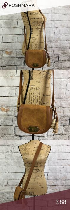 """Steve Madden Crossbody Brass Hardware BOHO tassels Steve Madden Crossbody Brass Hardware BOHO tasseled bag  Twist entry with brass lock  Tri-tassel adornment  Brass Steve Madden plate across the back  Super soft vegan leather  Clean inside and out  One zip pocket inside  Enough room for a phone and a small wallet  NWOT 8""""L X 6""""H X 6"""" W Strap drop 23""""  Bundle and save Steve Madden Bags Crossbody Bags"""