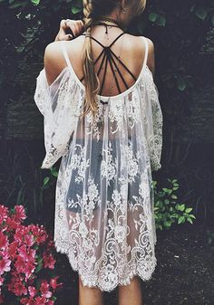 Pack this gypsy boho lace cover up in your bags and have an adventure-filled summer vacation at a beach. This white cover up features sheer ...