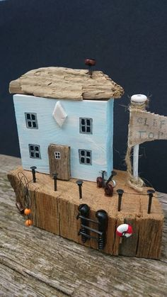 Check out this item in my Etsy shop https://www.etsy.com/uk/listing/450963542/cliff-tops-handmade-driftwood-cottage