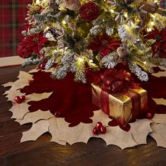 Create a luxe Christmas look with Pier 1's red velvet Holly Berry Tree Skirt, trimmed with gold holly appliques accented with tassels and berries.