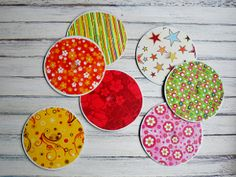 Recycled CD Coasters - These fun Recycled CD Coasters from @Amanda Formaro  are a great way to put old CD's to good use.  This fun collection of coasters makes a great gift and is so budget friendly.  CD crafts like this are also great for group activities and craft nights with your kids.