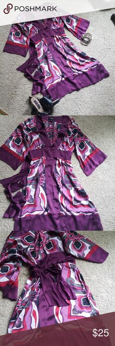 bebe kimono style sleeve dress Purplish burgundy with shades of brick red and lavender. Silky feel to it. Super comfortable. Wouldook cute with boots or sexy heels. Dress it up or down. You can't go wrong when you choose to wear thus number. It is to small for me now. Hidden side zipper for easy on easy off dressing. I think a small could wear this. bebe Dresses