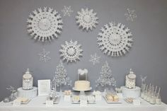 Let It Snow Dessert bar in shades of white and silver. This theme would be perfect for a Christmas party that is scheduled after Christmas.