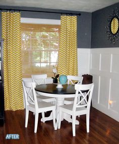 i love this room: the gray walls, the sunny yellow curtains, and most of all that beautiful two-tone dining set...