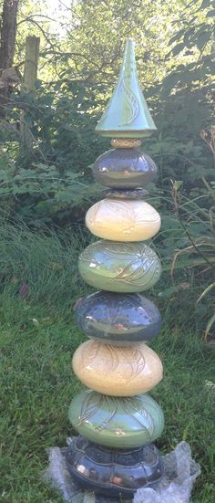 Garden Totem by PaulaBarryCeramics. I still think something like this would make a great collaborative class project.