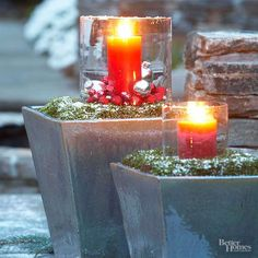 Don't want to mess with plants? Put your containers to other use! Here, two simple glazed pots are filled with sand and topped with a bed of dried moss. They play host to battery-powered candles in simple cloches./