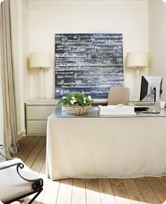 feminine touch to a desk (could add pleat or ruffle...). allow a cutout for cords and it hides the clutter too!