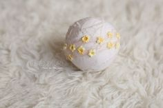 Four rows of peach mohair, embellished with sweet yellow flowers. Elasticated in the back.Newborn sizeImages by,Mj. Photography