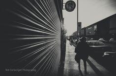 black and white bw monochrome street photography streettogs urban city north london finsbury park blackstock road leading lines low sun backlit nikon rob cartwright
