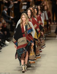 It's the blanket brigade! Cara Delevingne leads the finale at Burberry's AW14 show, which proved that the blanket will be the coolest way to wrap up warm this winter