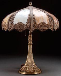 A GILT METAL AND SLAG GLASS TABLE LAMP, : Lot 754