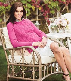 A cozy cabled sweater in a punchy pink spring hue.