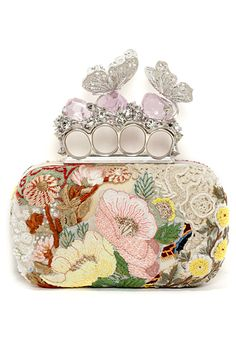 Flowers and butterflies were everywhere at Paris Couture this Spring--this McQueen knuckle clutch rolls them both into one accessory.