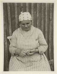 Leena Pattonen nalbinding in 1937. Kontiolahti, Northern Carelia, Finland.