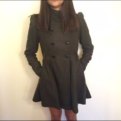 Green coat In good condition. Dark green long coat with buttons and 2 pockets in the front . Shoulders puff up.. One button seems to be a little dangled off can be easily sewed on tighter   ❌Do not ask for my lowest, make an offer instead  ❌Serious Buyers ONLY  ❌ No Trades Jackets & Coats