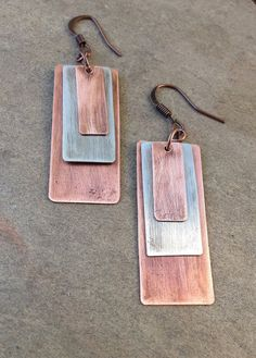 "Graduated sizes of copper and silver-alloy rectangles, connected with small oxidized copper rings and ear hook. Approx 2"" in length, very light weight and great movement!"