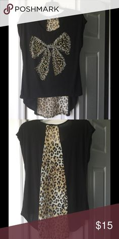 Cheetah print top Black, cheetah printed, low high top. It's in amazing condition and has only been worn a few times.                                                                     Perfect for the summer 🌀 Preloved 🌀 Reasonable offers welcomed Tops Tees - Short Sleeve