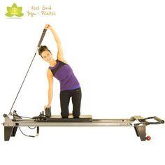 side bend press pilates reformer exercise 2