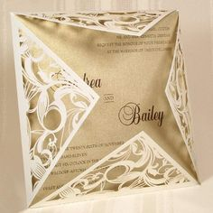"Pretty!! :) Off-White Shimmer Laser Cut Couture by Storkie Express: This gorgeous invitation features a spectacular, laser-cut wrap that surrounds your insert card. Gorgeous swirls are intricately laser cut into this wrap, revealing the insert card within. Your custom text is imprinted with raised lettering on your choice of insert card. Many different card stock color options, including shimmer, are available. A must see Storkie exclusive!    Dimensions: 6.25"" x 6.25"" (W x H)."
