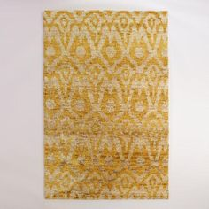 One of my favorite discoveries at WorldMarket.com: 6'x9' Yellow Ikat Hand-Knotted Jute Nadia Area Rug