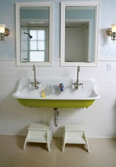 source: Upscale Construction Fun children's bathroom with cast iron utility sink, faucets, subway tiles backsplash, twin white mirrors, blue walls color and white stools. decorpad.com