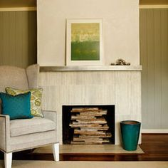 Stainless floating shelf as mantle. Tile fireplace surround.