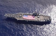 – USS Nimitz (CVN crewmembers participate in a flag unfurling rehearsal with the help of family and friends on the ship's flight deck during a Tiger Cruise. The Nimitz. Tiger Cruise, Carrier Strike Group, Uss Nimitz, Flight Deck, Usa Flag, Us Navy, Pacific Ocean, The Help, The Good Place