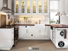 Love the dark butcher block counters to go with white cabinets and white subway tile backsplash (Ikea kitchen)