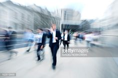 Stock Photo : Crowd of Business People, Businessman Using Mobile Phone, Blurred Motion
