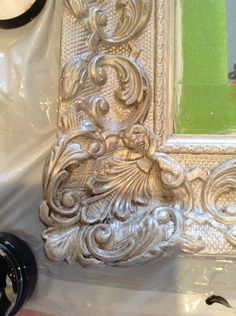 How to make an outdated mirror look antique with silver leaf paint, antiquing glaze and french gilding wax.