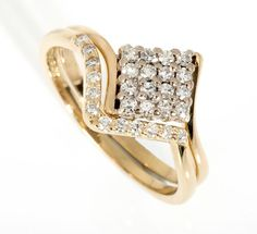 18ct yellow gold square cluster engagement ring and 18ct yellow gold shaped diamond wedding ring.