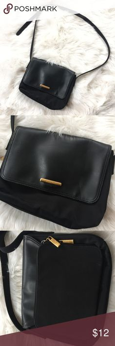 Nine West Crossbody Faux Leather Black Handbag Shoulder bag worn 10-12x. Great organizer bag!! The back Zipper pocket has 5 card slots, a Zipper pocket, and one empty pocket. The main compartment has a divider and a Zipper pocket. Very sophisticated and classic bag Nine West Bags Crossbody Bags