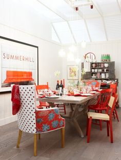 Sarah Richardson design with chairs upholstered in two fabrics.  The red makes this such a cheerful and comfortable space.  More two-tone chairs in the blog post.