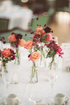 A bright and vibrant summer wedding in Wiltshire Coral rose centrepieces Simple Wedding Centerpieces, Simple Centerpieces, Wedding Flower Arrangements, Centerpiece Ideas, Graduation Centerpiece, Quinceanera Centerpieces, Candle Centerpieces, Floral Wedding, Wedding Flowers
