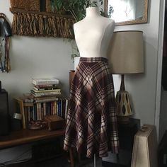 This skirt by College Town is long, warm and stylish - perfect for chilly weather! Fits like : Medium Waist: Length: Hip: up to Designer: College Town Condition: Excellent Fabric: Wool Chilly Weather, Wool Skirts, 1970s, High Waisted Skirt, Nerd, Stylish, Fabric, Image, Design