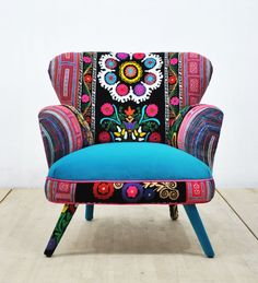 Retro style handmade armchair upholstered with Suzani, Thai Hmong and velvet fabrics. Beautiful combination of lovely colors. Seat and outer