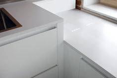 kitchen TIME 45° - detail of opening drawers handle-less 45°, in matt white lacquer finish