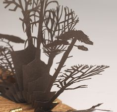Hidden Winter  - hand cut paper in wooden books by Lizzie Thomas