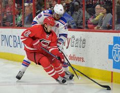 Rangers vs. Hurricanes:  March 9, 2017  -  The Rangers fell to the Carolina Hurricanes, 4-3, on Thursday at PNC Arena:    Sebastian Aho #20 of the Carolina Hurricanes and Marc Staal #18 of the New York Rangers vie for the puck during the game at PNC Arena on March 9, 2017 in Raleigh, North Carolina.