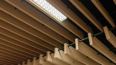 Solid Wood Grill System by Hunter Douglas Architectural Wood Slat Ceiling, Baffle Ceiling, Wooden Ceilings, Ceiling Decor, Ceiling Beams, Ceiling Design, Wood Slats, Wood Paneling, Ceiling Texture