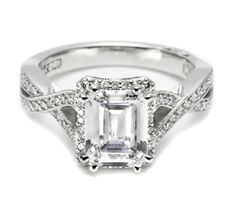 "Tacori-From our Dantela Collection, this unique setting creates a look that is a beautiful juxtaposition of modern, yet traditional; classic, yet unconventional. Dazzling pave and delicate milligrain detail decorate the unique criss-crossing shoulders of this high-polish band. Hand-set pave diamond spotlight enhancers which ""bloom"" the emerald-cut center stone."