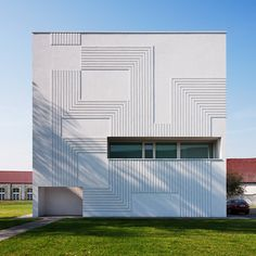 The facade of this computer research centre has a grooved pattern inspired by a circuitboard.