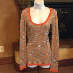Beautiful Stacia sweater top! Multi-color, Missoni style, scoop neck sweater. Lightweight and perfect for spring and summer! Very soft and fine knit fabric. Burnt orange trim compliments tanned skin. Pretty with white shorts. Light fuzz on sleeves, hardly noticeable because it blends in with fabric. Stacia Sweaters Crew & Scoop Necks