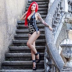 """Instagram media by swayfierce - """"The most courageous act is still to think for yourself. Aloud."""" Coco Chanel  @ausriefel Sulfur latex bodysuit  Photo by @alexpg75 (cropped)  #heels #highheels #ausriefel #latex #latexdesign #fetish #latexfetish #fetishmodel #inkedgirl #tattooedgirls #redhair #legs #tattoo #rubber #latexgirl #fetishgirl #tattoomodel #altmodel #occult"""