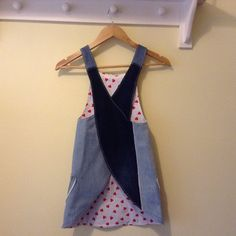 Girls Japanese cross strap apron handmade from up-cycled denim jeans. So unique why not wear team with leggings or wear as a dress