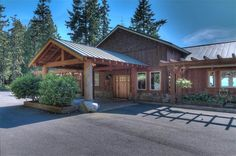 The upper home features an inviting porte-cochere milled with old growth logs reclaimed from the property, hand scribed boulders and Sockeye Red rock sidewalks.